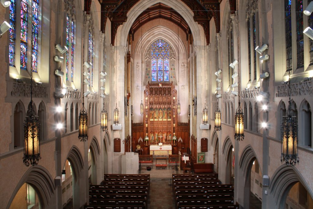 A view of the sanctuary inside of Historic Trinity Lutheran Church of Detroit, also showing Parker Reed Lighting's LED fixtures with McWong International's wireless bluetooth mesh modules